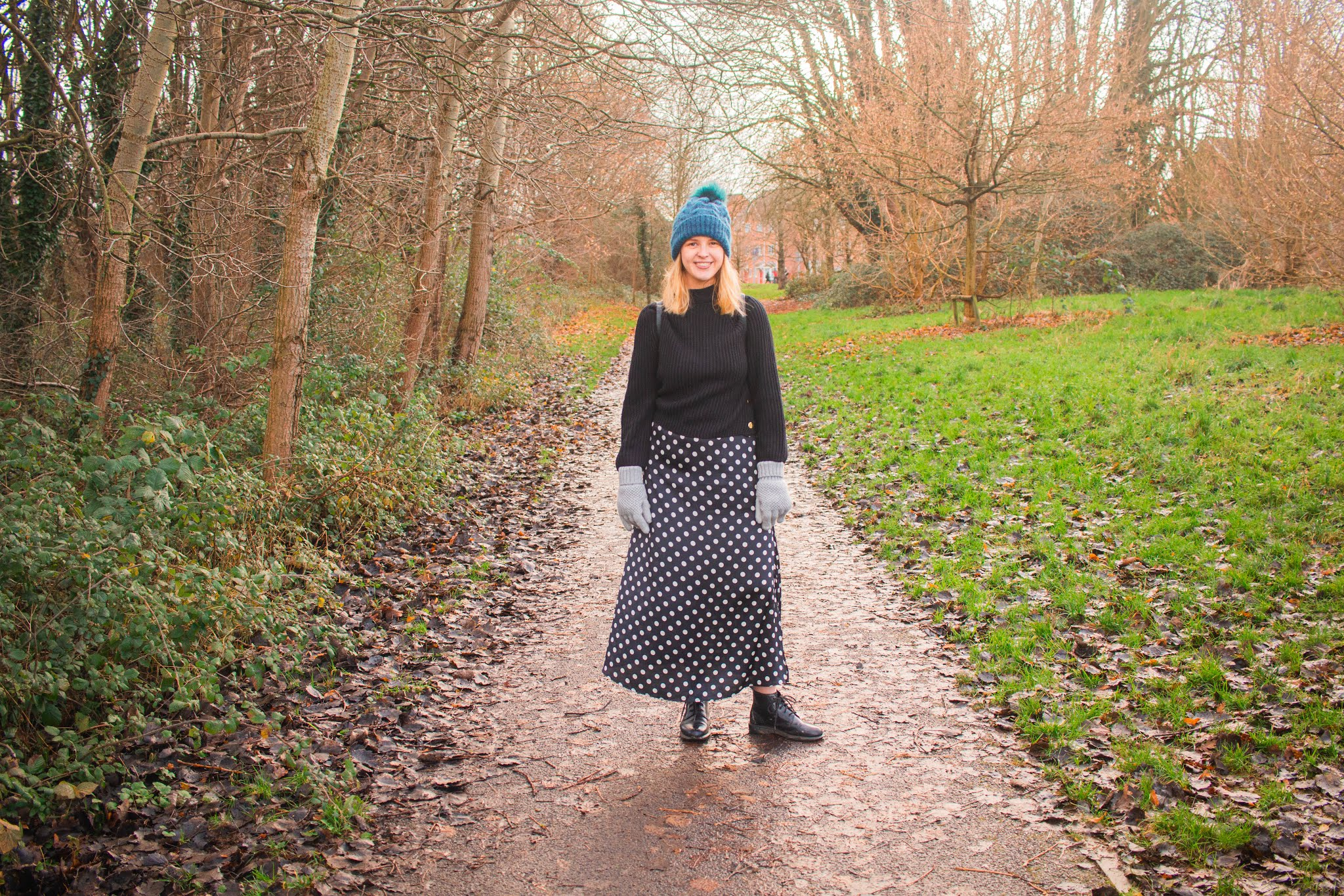 fashion blogger chloeharriets wearing polka dress, jumper and hat, walking through nature, smiling, how to relieve stress blog self-care intentional living