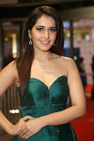 Raashi Khanna in Dark Green Sleeveless Strapless Deep neck Gown at 64th Jio Filmfare Awards South ~  Exclusive 142.JPG