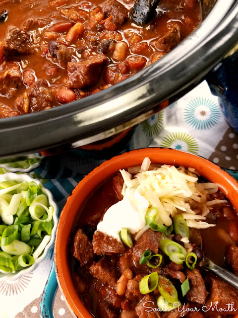 Slow Cooker Chipotle Steak Chili! A crock pot chili recipe with tender steak, smoky chipotle peppers, mexican spices and the perfect blend of beans.