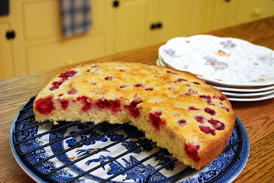 raspberry cake cooking on rack