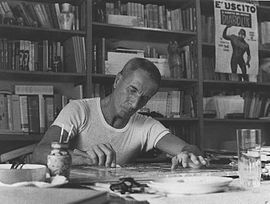 Dino Buzzati, pictured in his studio, was almost as prolific as a painter as he was a writer