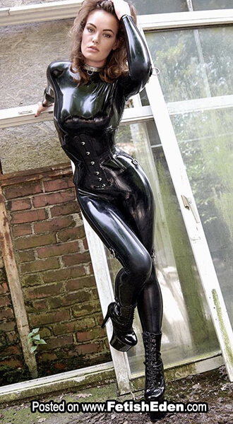 Hot lady in black latex catsuit with black latex corset