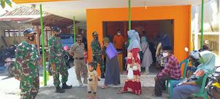 Pengamanan Pendistribusian BST Di Kecamatan Sumberasih Oleh Babinsa