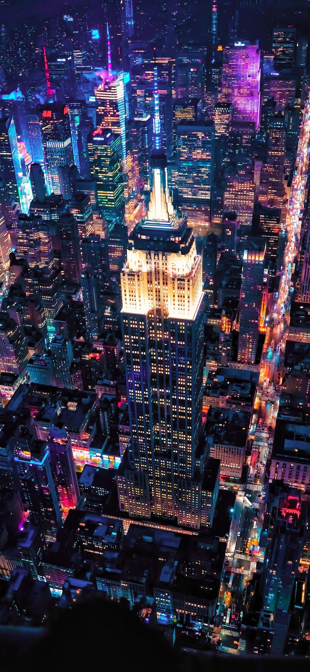 aerial view of city buildings during night wallpaper