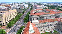 Protesters march away from the US Capitol on Saturday in Washington.(Credit: cnn.com) Click to Enlarge.