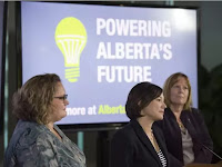 From left, Deputy Premier Sarah Hoffman, Shannon Phillips is the Minister of Environment and Parks and the Minister Responsible for the Climate Change Office.and Marg McCuaig-Boyd, Energy Minister. The Alberta government outlined their plan to move away from coal fired electricity at the Federal Building in Edmonton on November 24, 2016. Photo by Shaughn Butts / Postmedia Stuart Thomson Story For a Stuart Thomson/CP story running in the Sun and Journal. (Credit: Shaughn Butts / Edmonton Journal) Click to Enlarge.
