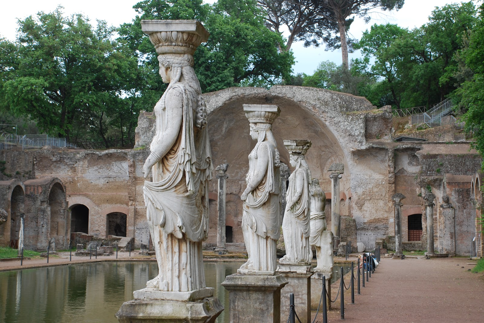 Statues by the formal pond at villa adriana