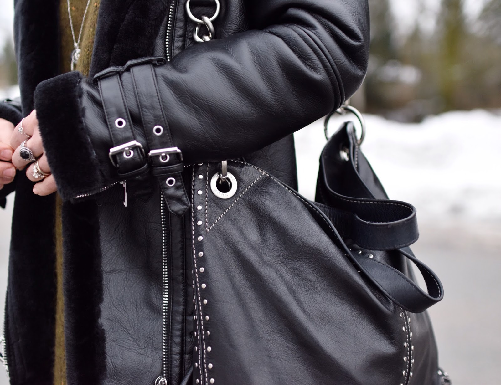 Monika Faulkner outfit inspiration - black aviator jacket, MK stud-embellished bag