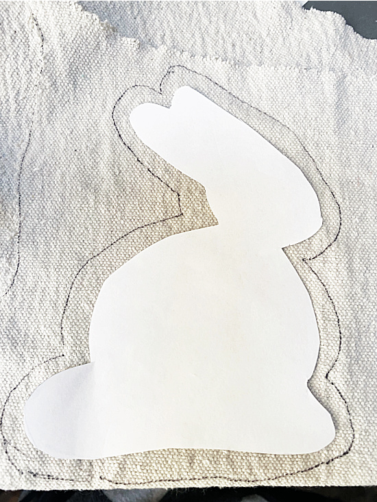 silhouette of bunny on drop cloth and traced