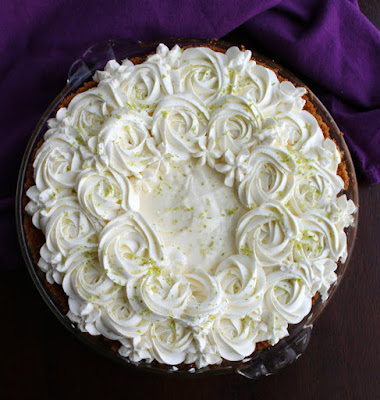 creamy no bake key lime pie with cream cheese whipped cream rosettes and lime zest