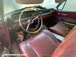 Red interior of 1962 Pontiac Grand Prix loaded with options.