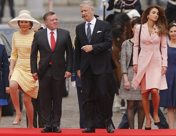 King Philippe and Queen Mathilde of Belgium welcome King Abdullah and Queen Rania of Jordan during an official welcome ceremony at the Royal Palace in Brussels