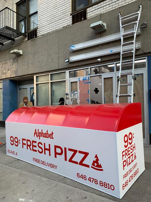 Marking The Arrival Of Alphabet 99 Cent Fresh Pizza Awning
