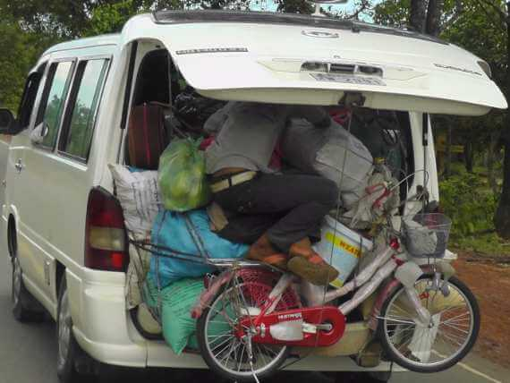 Man crammed among belongings falling out of back of van. Van life! #Vanlife!