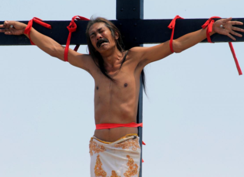 Meet Ruben Enaje: The man who has been nailed to the cross annually for 32 years to re-enact Jesus Christ's crucifixion