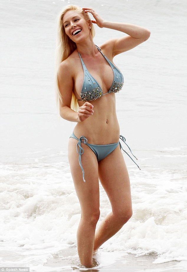 Another day, another bikini shoot! Heidi Montag shows off her $30,000  surgically-enhanced body in a sparkling blue bikini