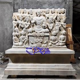 Relief budha dari batu alam putih jogja