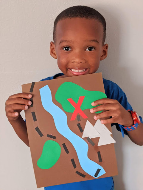African American preschooler holding a DIY treasure map