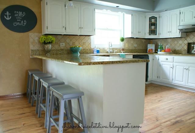 backless gray wooden bar stools kitchen bar marble countertops