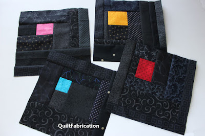 black quilt blocks with colored centers