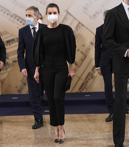 Queen Letizia wore a new black puff-sleeve taffeta knit top and trousers from Manuel Pertegaz