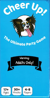 The box cover for Cheer Up! A light blue background with the title in white text at the top, under that is a cartoon drawing of a king charles spaniel.  The tagline reads 'The Ultimate Party Game' and  black banner beneath it reads 'Waring: Adults Only!'
