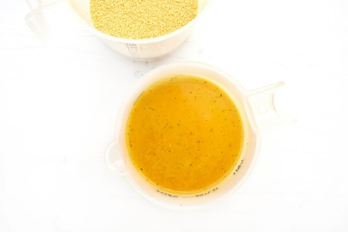 couscous and vegetable stock in jugs