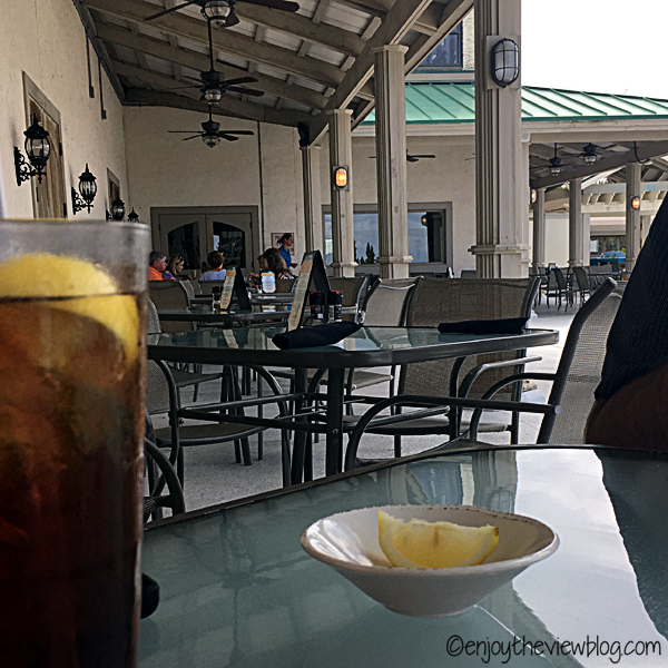 Outdoor seating at Sunset Bay Cafe in the Sandestin resort.