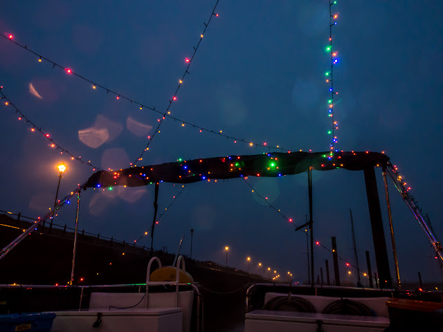 Photo of lights strung across Ravensdale's aft deck