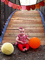 PostalThreads blog welcome. photo prop yellow balloon ball, bunting, bridge and baby