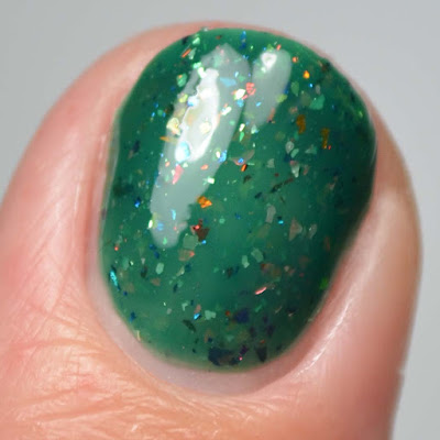 green nail polish with flakies close up swatch