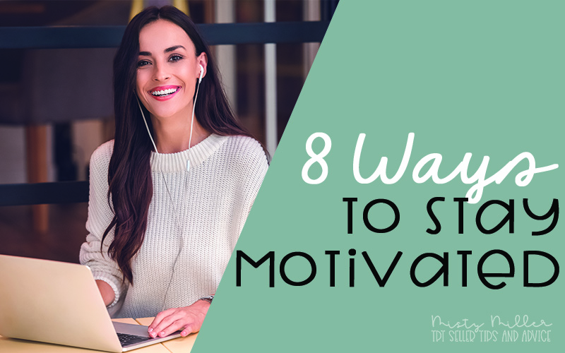 8 Ways to Stay Motivated, woman at coffee shop smiling while on her laptop