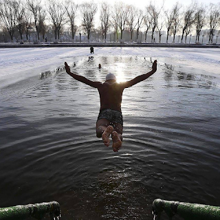A member of China's Beiling Winter Swimming team