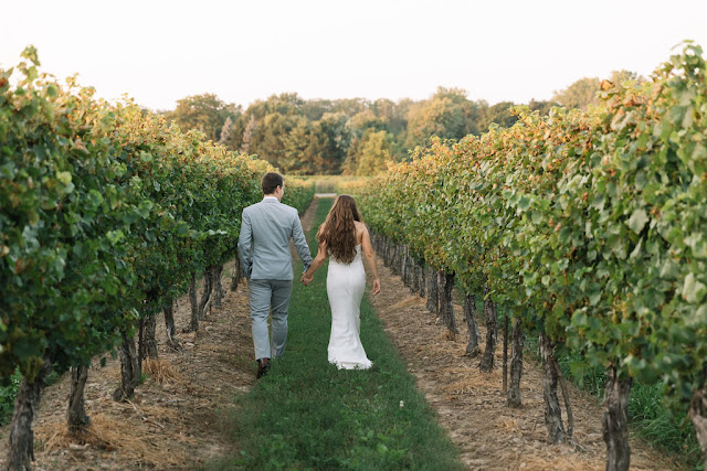 Niagara Wedding Planner | A Divine Affair - Photo by Erin Blackwood Photography. Kurtz Orchards Gracewood Estate Wedding in Niagara on the Lake. Wedding Details. Alfresco live edge harvest tables in the orchard.