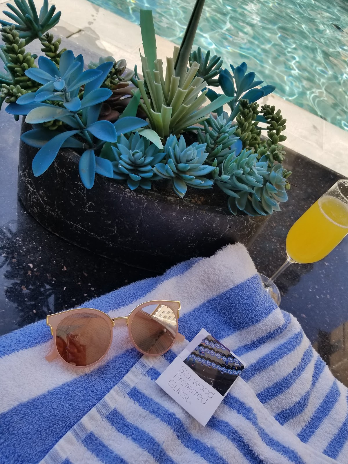 Sunglasses and mimosas poolside for the Starwood Preferred Guest