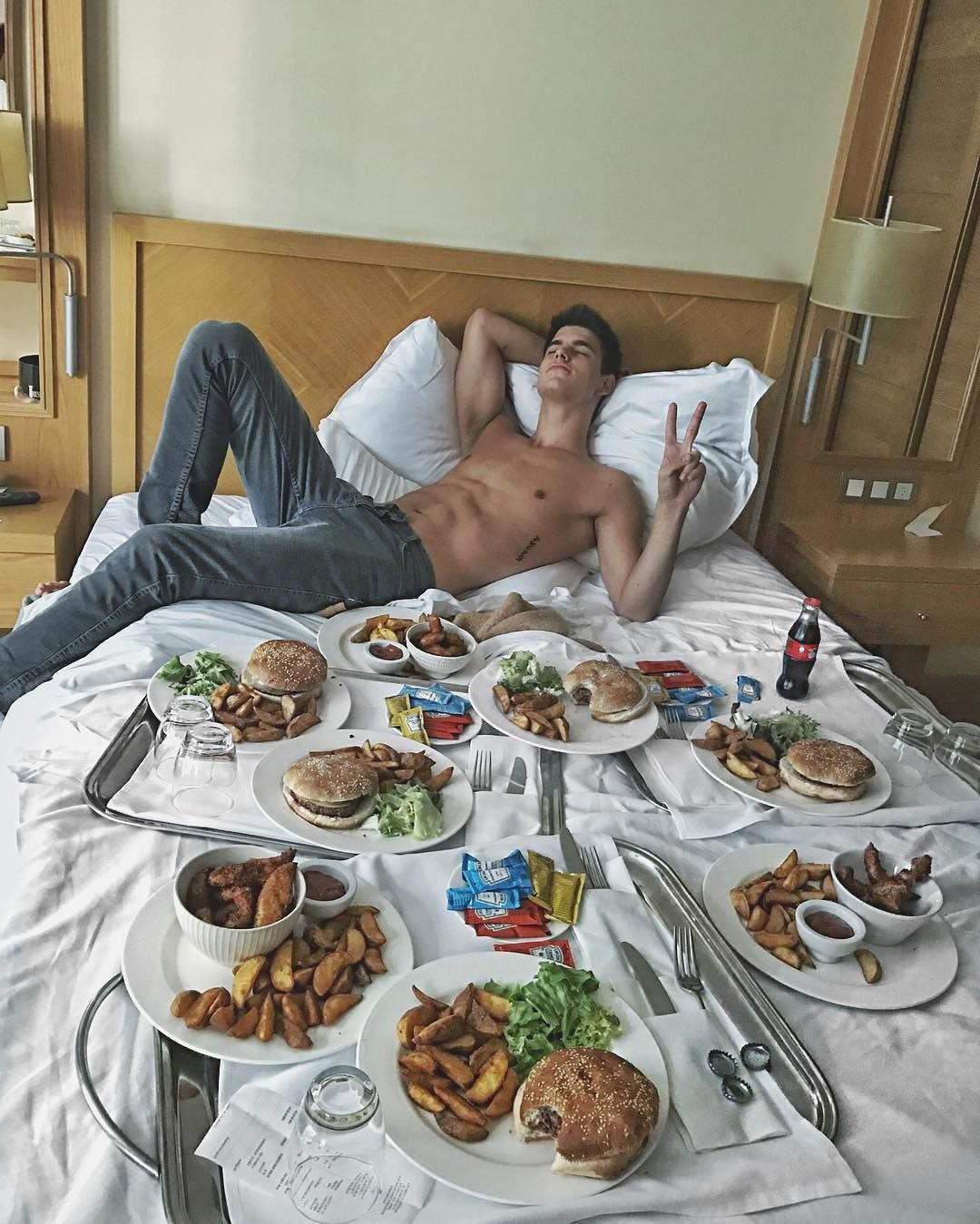 cute-boy-chillin-shirtless-laying-bed-jeans-food-hotel-room-fun