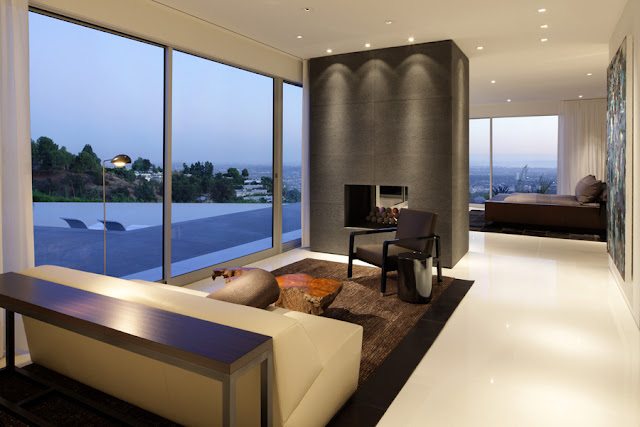 Fireplace by the glass wall