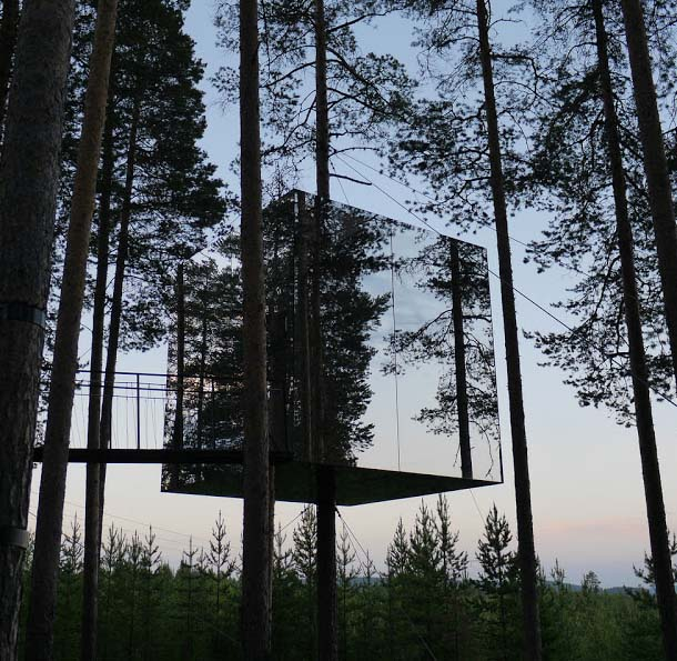 """Tree hotel, Harads is actually a forest of pine having seven exclusive """"tree rooms"""" and many are in the pipeline to develop in the upcoming future. Tree hotel has a natural bird's nest, an incredible mirror cube, glass capsule like huts and a UFO (that recalls us the last scenes in E.T.) along with a tree steam bath."""