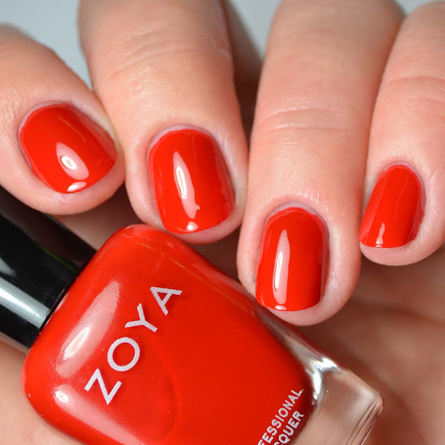 bright red nail polish swatch on four fingers
