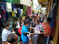 Baksos DPP KNPI Berlanjut, Kini Bagikan Makanan Siap Saji & HandSan ke Warga, 400 Paket per Hari