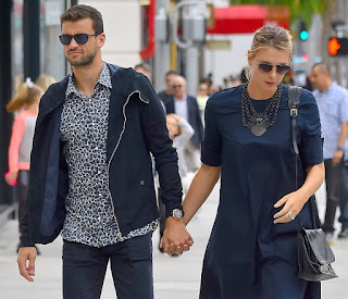 Maria holding hands with Grigor in public