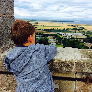 Boy looking over a wall