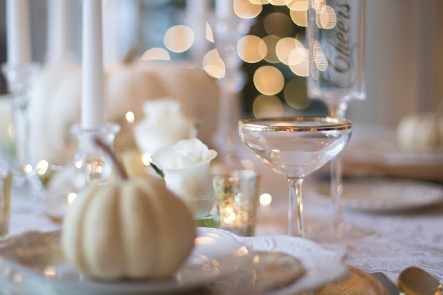 fancy table setting with white mini pumpkin