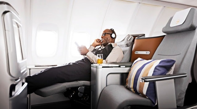 is it worth flying business class cost first class flight seat