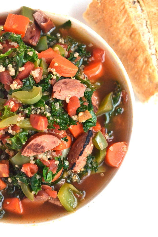 Smoky Sausage, Kale and Quinoa Soup is the perfect hearty, nutritious soup that is full of flavor and spice that your family will love! www.nutritionistreviews.com