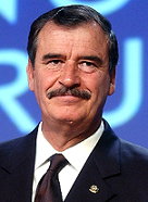 De World Economic Forum from Cologny, Switzerland - Vicente Fox - World Economic Forum Annual Meeting Davos 2003, CC BY-SA 2.0, https://commons.wikimedia.org/w/index.php?curid=85877324