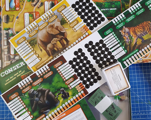 Conservation Crisis game review box contents strewn across table