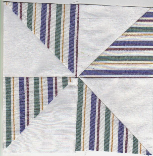 Stripes and solids with four half-square triangle blocks makes pinwheel