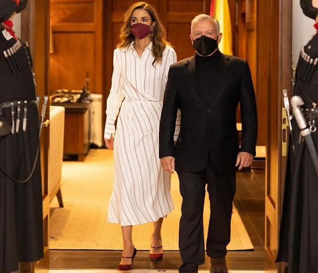 Queen Rania wore a new Claudi asymmetric striped poplin wrap dress from Joseph