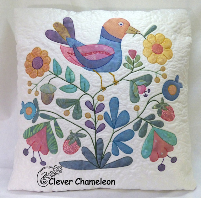 Learn how to do shadow appliqué and make a scrappy pillow cover. Tutorial by Clever Chameleon Quilting.